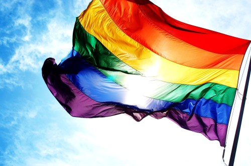 Rainbow flag and blue skies, the flag of the LGBT (Source: grayfords.co.uk)
