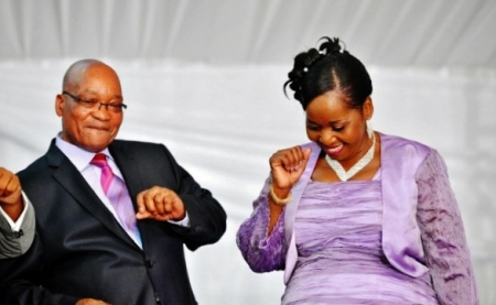 In this photo, taken on April 20, 2012, President Jacob Zuma and his fiance, Ms Bongi Ngema, dance at his home in Nkandla, KwaZulu Natal.  (Source: afp/Elmond Jiyane)
