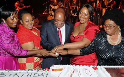 President Jacob Zuma and his current wives cutting his birthday cake (source: thepromota.co.uk)