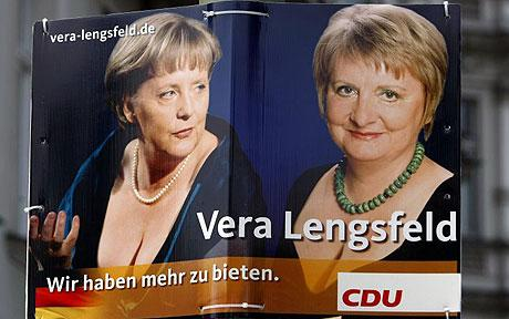 An election campaign poster for the 2009 general election with the words ' We have more to offer' shows German Chancellor Angela Merkel (R) and Vera Lengsfeld (Photo - REUTERS)
