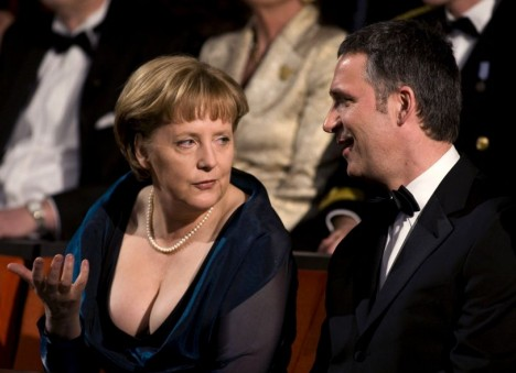 Don't look down: Angela Merkel with Mr Stoltenberg last night (Source: dailymail.co.uk)
